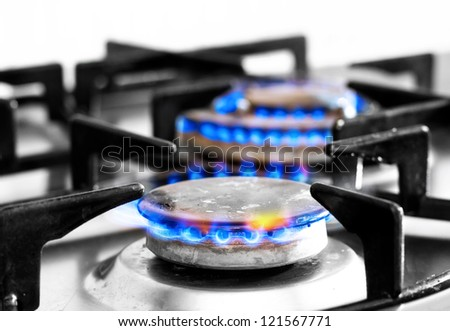 cooker gas hob with flames burning - stock photo