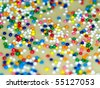Cookie and Cake Icing and Rainbow Colored Sprinkles - stock photo