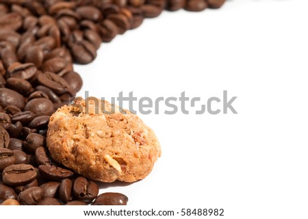 Cookie and coffee beans on white background