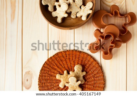 cookie cutters against wood background - stock photo