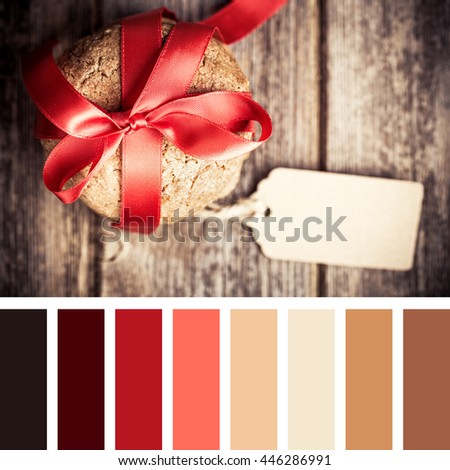 Cookie gift with tag over old wood background. In a colour palette with complimentary colour swatches - stock photo