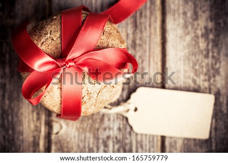 Cookie gift with tag over old wood background, with space for your text. Intentional vignette and shallow depth of field with retro style processing. - stock photo
