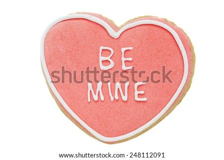 Cookie, Heart shaped biscuit with pink and white frosting on white background - stock photo