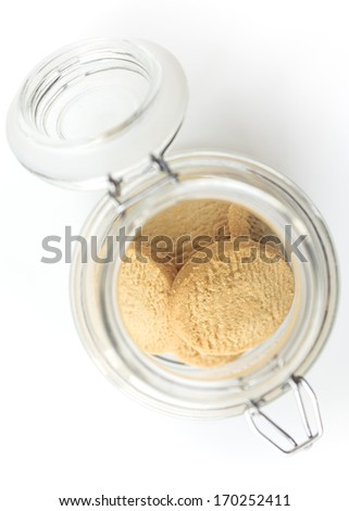 Cookie jar with cookies white background