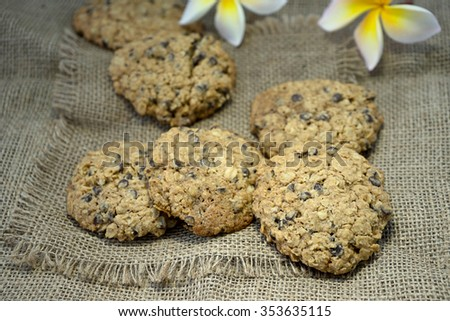 cookie on  burlap cloth with plumeria flower
