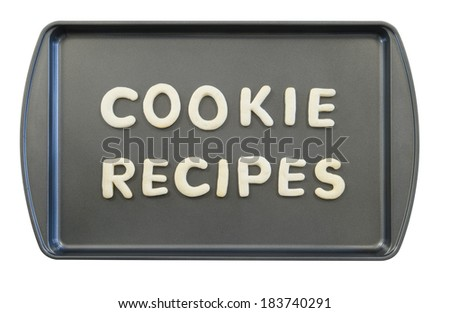 Cookie recipes spelled out with alphabet cookies on a non stick cookie sheet - stock photo