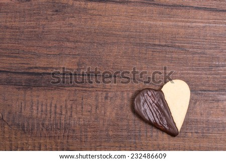 Cookie with couverture chocolate as heart shape and free space - stock photo