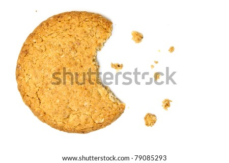 Cookie with crumbs overhead view isolated on white - stock photo