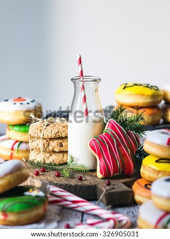 Cookie with milk and christmas tree on the table for Santa Claus - stock photo