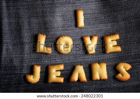 Cookies ABC in the form of word I LOVE JEANS alphabet on old jean background, Valentines day - stock photo