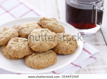 cookies and black coffee on white wooden background. break. coffee time.