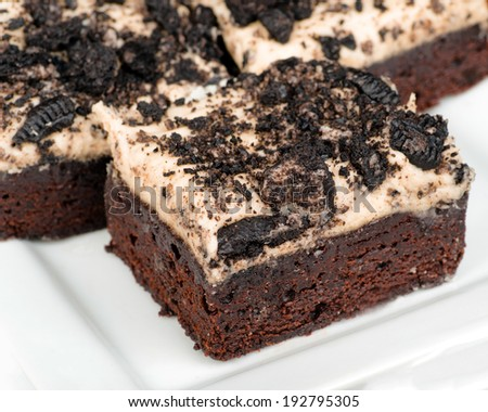 Cookies and cream brownies with topping made from Oreo cookies - stock photo