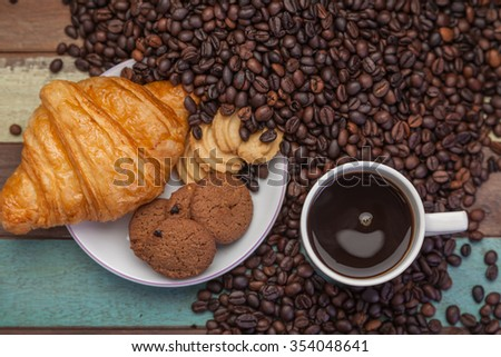 Cookies and cup of coffee with beans - stock photo