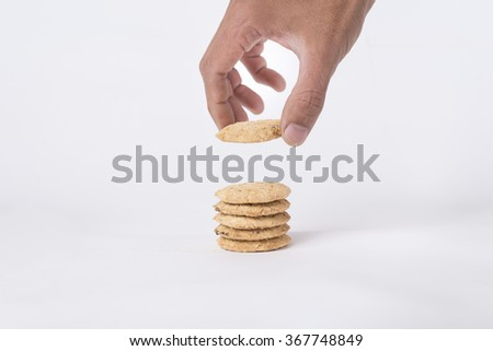 cookies and hand take a cookie