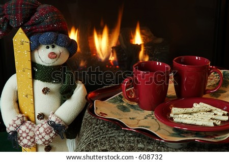 Cookies and hot drinks by the fire. - stock photo