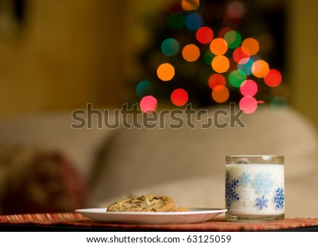 Cookies and milk left out for Santa - stock photo