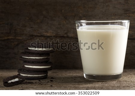 Cookies and milk over wood - a sweet dessert - stock photo