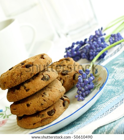 cookies and spring blue flowers - stock photo
