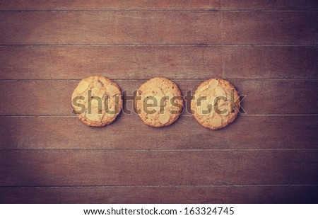 Cookies at wooden background  - stock photo
