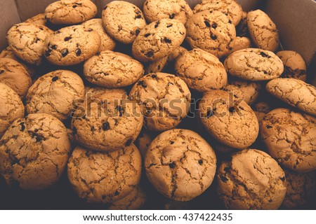 Cookies background. Sweet chocolate chips biscuits and cookies texture background. Oatmeal, chocolated drops and other sweets. Dessert, sweets for tea. Fattening sweets concept - stock photo