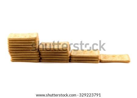Cookies crackers stacked tower ascending on a white background