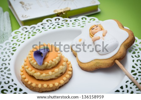 Cookies for a First communion decorated with fondant - stock photo