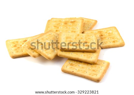 Cookies heap of crackers on a white background