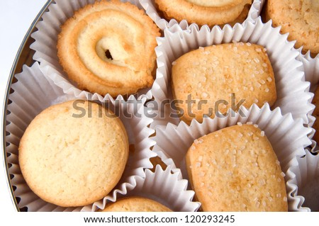 cookies in a round tin box isolated on white - stock photo
