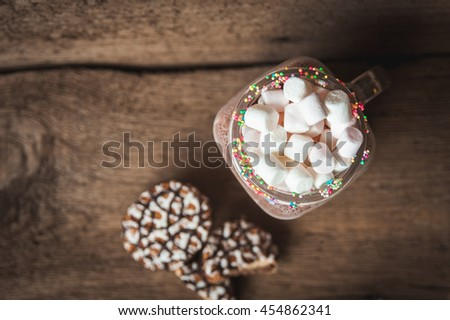 Cookies in chocolate and a bottle of cocoa with marshmallows. Wooden background - stock photo