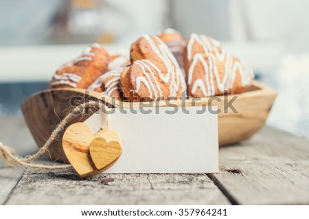 cookies in the shape of a heart with a paper tag for your message - stock photo