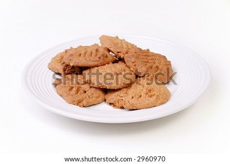 Cookies on plate isolated on white. - stock photo