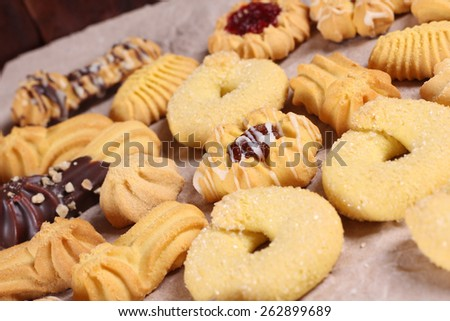 Cookies on the table. Delicious cookies from the dough on the paper. Background, texture of the cookie. Confectionery. A restaurant, a coffee shop, a pastry shop. - stock photo