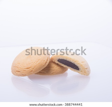 cookies or cookies with chocolate filling on background - stock photo