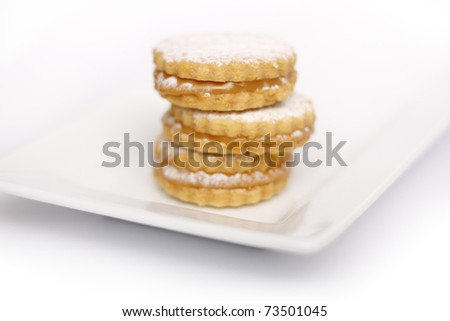Cookies (Peruvian or Argentinian Alfajores) served on a plate - stock photo