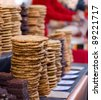 cookies piled up on a counter in a shop. - stock photo