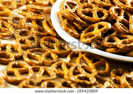 Cookies pretzels on a white plate.