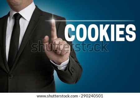 cookies touchscreen is operated by businessman. - stock photo