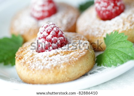 Cookies with a raspberry - stock photo