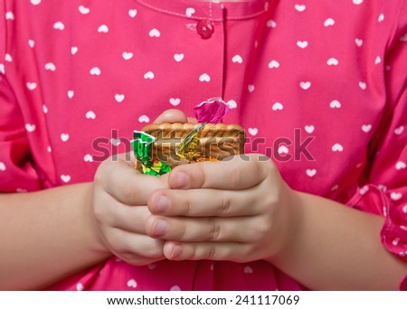 Cookies with candy, trapped in children's hands at chest - stock photo