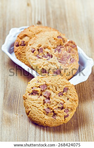 Cookies with chocolate pieces on wooden table. Close up. - stock photo