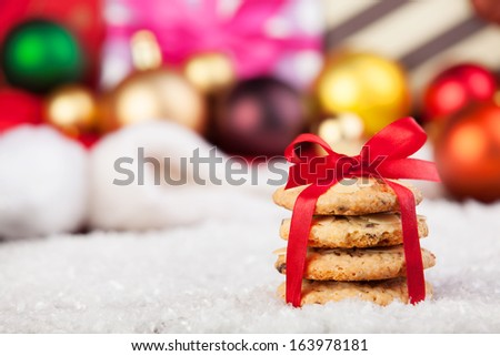 Cookies with christmas gifts on wooden table