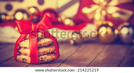 Cookies with christmas gifts on wooden table - stock photo