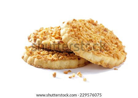 cookies with crushed nuts  on white background - stock photo
