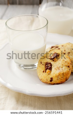 Cookies with delicious milk, sweet food - stock photo