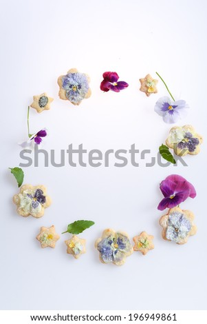 Cookies with edible flowers - stock photo
