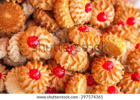 Cookies with red fruit jelly as a background for design - stock photo