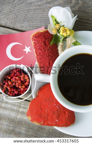 cookies with red  glaze as Turkish  flag colors. cup of coffee and a homemade flag of Turkey, decorative patriotic breakfast lunch. Selective focus photo image - stock photo