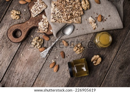 Cookies with seeds  honey  and nuts on wooden table. Rustic style and autumn food photo - stock photo