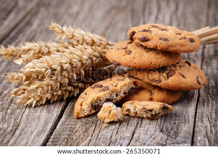 Cookies with wheat on a wooden table. - stock photo