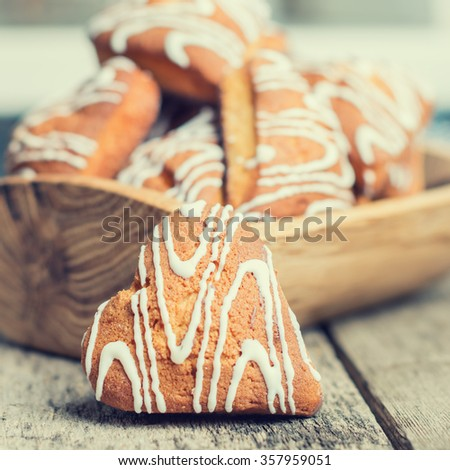 cookies with white frosting in the shape of heart  - stock photo